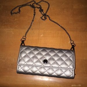 Wallet with arm chain